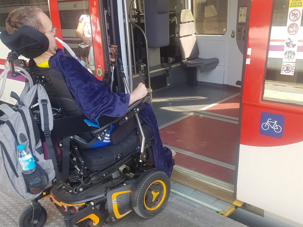 A wheelchair user boarding a train independently