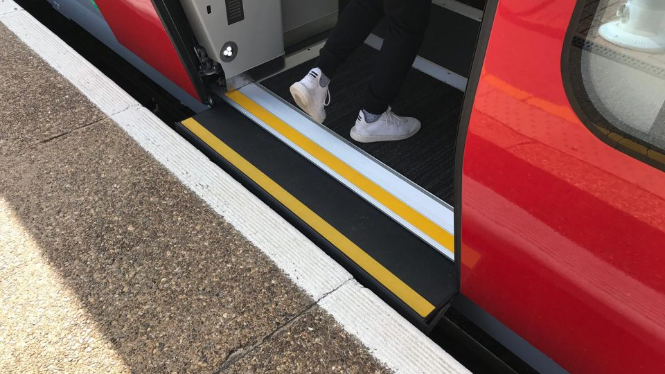 Train door at platform showing level boarding